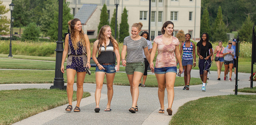 students walking up the path from the residence halls