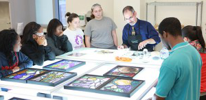 stained glass students watching a demonstration during class