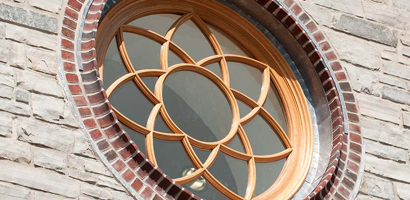 Brickman Center rose window with wood detailing in the shape of a flower