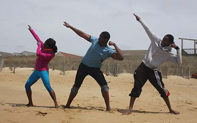 students posing on beach